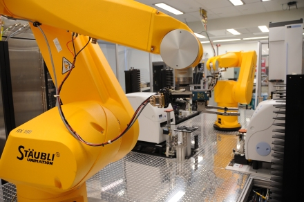 """""""Chemical Genomics Robot"""" by Maggie Bartlett, National Human Genome Research Institute - http://www.genome.gov/dmd/img.cfm?node=Photos/Technology/Research%20laboratory&id=79299. Licensed under Public Domain via Wikimedia Commons"""